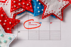 Highlighting christmas date on calendar Royalty Free Stock Images