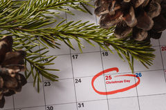 Highlighting christmas date on calendar Royalty Free Stock Photo
