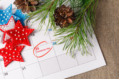 Highlighting christmas date on calendar. Coming xmas day. Highlighting christmas date on calendar Royalty Free Stock Photo