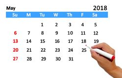 Highlighting date on calendar. Hand highlighting date on calendar Stock Image