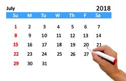 Highlighting date on calendar. Hand highlighting date on calendar Royalty Free Stock Photography