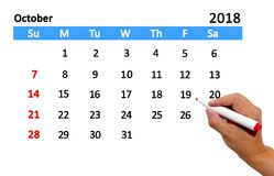 Highlighting date on calendar. Hand highlighting date on calendar Royalty Free Stock Photos