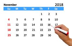 Highlighting date on calendar. Hand highlighting date on calendar Stock Images