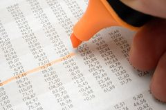 Highlighting Numbers. Marking business numbers in a financial newspaper Royalty Free Stock Photo