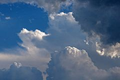 HIGHLIGHTS ON THE PEAKS OF CLOUDS Royalty Free Stock Photo