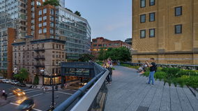 The Highline at dusk with passing people. Chelsea, Manhattan, New York CIty stock footage