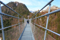 Highline 179 longest 406 meters rope bridge in the world in Alps mountains. Tyrol, Austria. Stock Photos