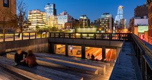 The Highline and 10th Avenue at twilight with city lights in Chelsea, Manhattan, New York City. The High Line at twilight with a view on 10th Avenue with royalty free stock image