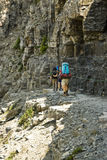 Highline Trail. Backpackers on the Highline Trail in Glacier National Park Royalty Free Stock Image