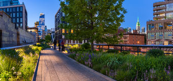 The Highline at twilight. Chelsea. Manhattan, New York City. Highline panoramic view at twilight with city lights, illuminated skyscrapers and high-rises royalty free stock photos
