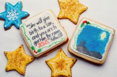 Decorated Christmas Cut Out Cookies With Scripture Verse. Highly decorated and colorful Christmas cut out cookies that are homemade and have a scripture scene Royalty Free Stock Images