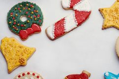 Decorated Christmas Cut Out Cookies on White. Highly decorated and colorful Christmas cut out cookies that are homemade and set on white with copy space in the Royalty Free Stock Image
