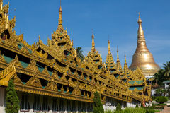 The highly decorated covered approach to the Shwedagon pagoda -. The Shwedagon pagoda showing the highly decorated covered approach - landscape Stock Image