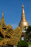 The highly decorated covered approach to the Shwedagon pagoda. The Shwedagon pagoda showing the highly decorated covered approach - portrait Stock Image