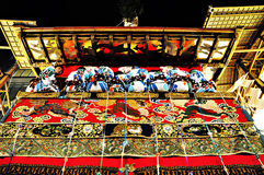 A highly decorated float along with its accompanying men in trad Royalty Free Stock Images