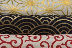 Highly detailed all over background texture of traditionals japaneses red, gold and white and black hemp leaves or rainbow shape royalty free stock photography