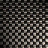Highly detailed carbon fiber. A carbon fiber background texture. A great art element for your print or web design piece.  There is a lot of detail in the fibers Royalty Free Stock Photography