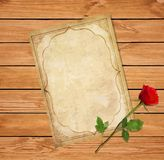 Old blank paper script and elegant red rose on wooden background stock illustration