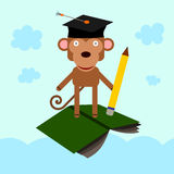 Highly educated. A graduated monkey standing on a flying book Royalty Free Stock Photo