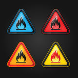 Highly flammable warning symbols. Hazard warning triangle highly flammable warning set symbols on a metal surface Royalty Free Stock Photo