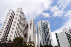 Highly populated public housing apartment estate. Highly populated public residential housing apartment estates in Hong Kong with sunny sky Stock Images