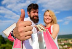 Highly recommend sale tips. Man with beard shows thumb up gesture. Advice shop now. Couple in love recommend shopping. Summer sale discount season. Couple with royalty free stock photos