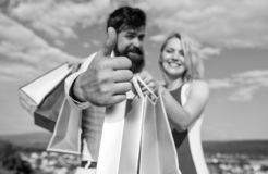 Highly recommend sale tips. Man with beard shows thumb up gesture. Couple in love recommend shopping summer sale. Discount season. Couple with shopping bags royalty free stock photography