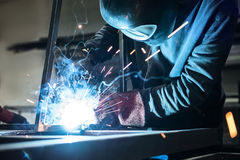 Highly skilled man is working in workshop stock photos