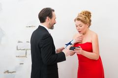 Highly surprised charming woman receiving a present royalty free stock images