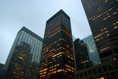 Highrise buildings. At dusk in midtown Manhattan, New York Royalty Free Stock Images