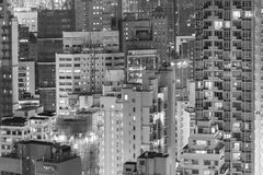 Highrise residential buildings in Hong Kong city. Highrise buildings in Hong Kong city at night Royalty Free Stock Photo