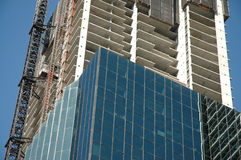 Highrise construction. Highrise building construction in progress Royalty Free Stock Photos