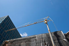 Highrise Construction Crane in Downtown Stock Photography