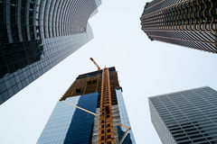 Highrise construction in Seattle. Seattle, WA, USA December 18, 2016: The Mark, a 43 story hotel/office building, rises up among other highrise buildings in Stock Photography
