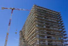 Highrise Construction Site. And tower crane Royalty Free Stock Images