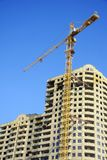 Highrise Construction Site on clear blue sky Royalty Free Stock Images