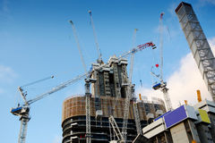 Highrise Construction Site with cloudy blue sky Stock Image