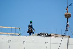 Highrise Construction Worker. Worker Construction of Highrise Building Royalty Free Stock Photo