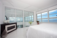 Highrise master bedroom Stock Images