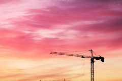 Highrise tower crane over sunset Royalty Free Stock Photography