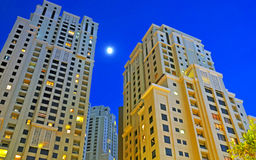 Highrise Towers at Night. The moon shining between two highrise towers in a Dubai Residential Development Royalty Free Stock Image