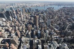 Highrise view of new yorks skyline. High rise view of New York City taken from the top of the Empire state building over looking the city and the hudson river Stock Photo