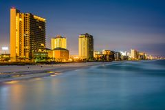 Highrises along the Gulf of Mexico at night, in Panama City Beach, Florida.  royalty free stock photography