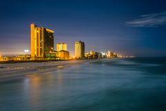 Highrises along the Gulf of Mexico at night, in Panama City Beach, Florida.  stock photography