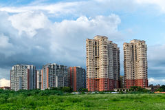 Highrises in a city. Tall buildings and residential complexes develop with spread of city stock photography