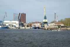 Highrises and cranes in the harbour of Klaipeda Royalty Free Stock Photos