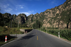 Highroad and Mountain. Mountain and highroad  blue sky Stock Image
