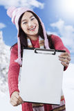 Highschool student displaying empty clipboard Royalty Free Stock Images
