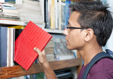 Highschool Student Picking a Book Royalty Free Stock Images