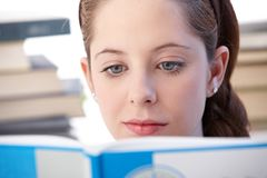 Highschool student reading exercise book. Closeup portrait of highschool student reading exercise book Stock Image